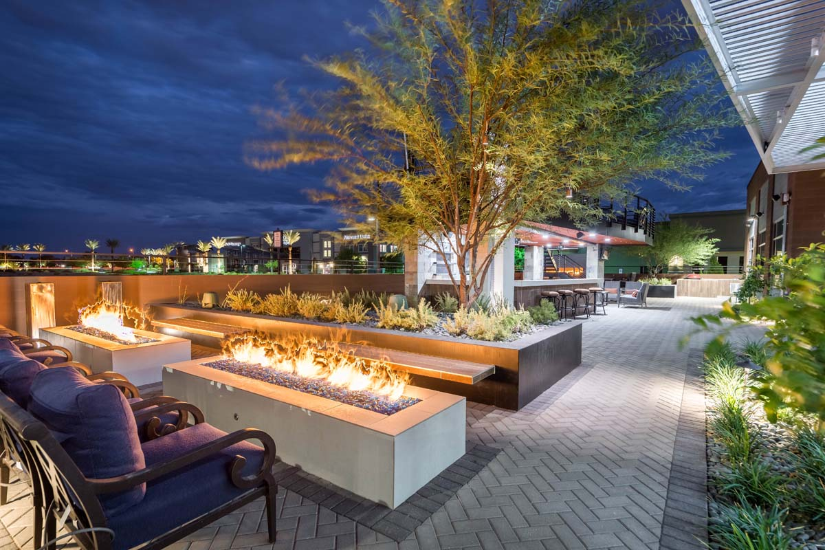 Lounge area outside of restaurant with fire pits