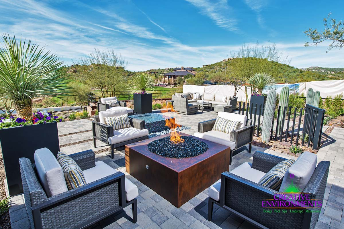 Custom fire pit area with surround seating and desert landscape