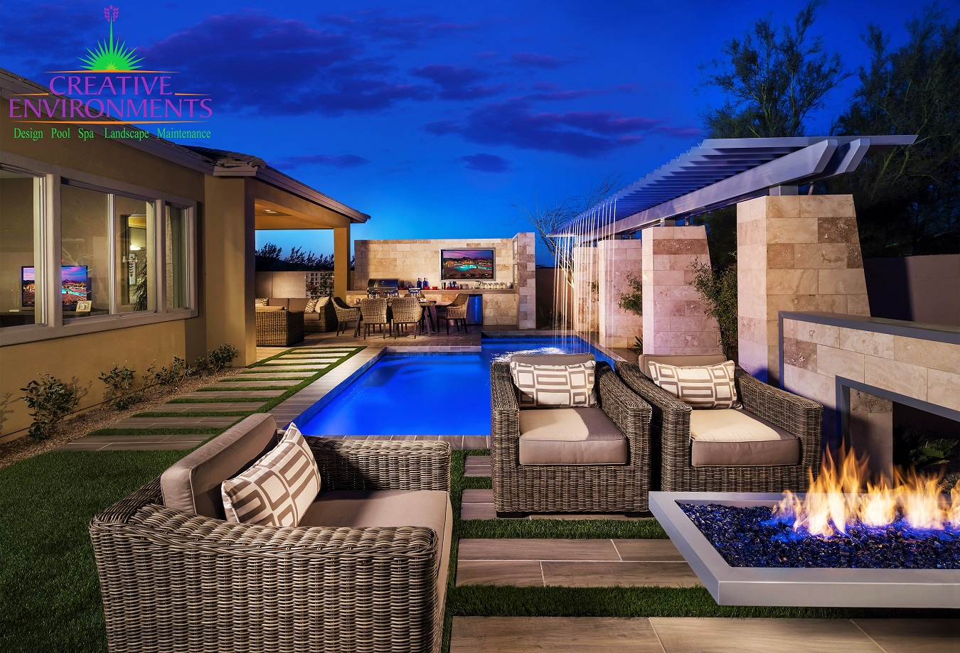 Custom floating fire pit with rectangular pool and metal pergola
